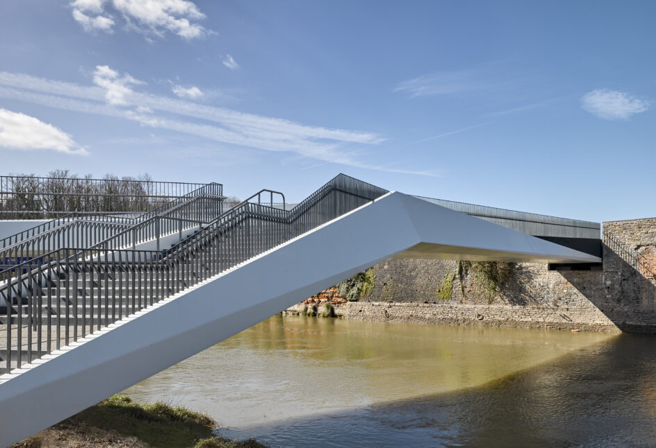 Edge beam and parapet view of footbridge crossing the River Avon in Bristol.