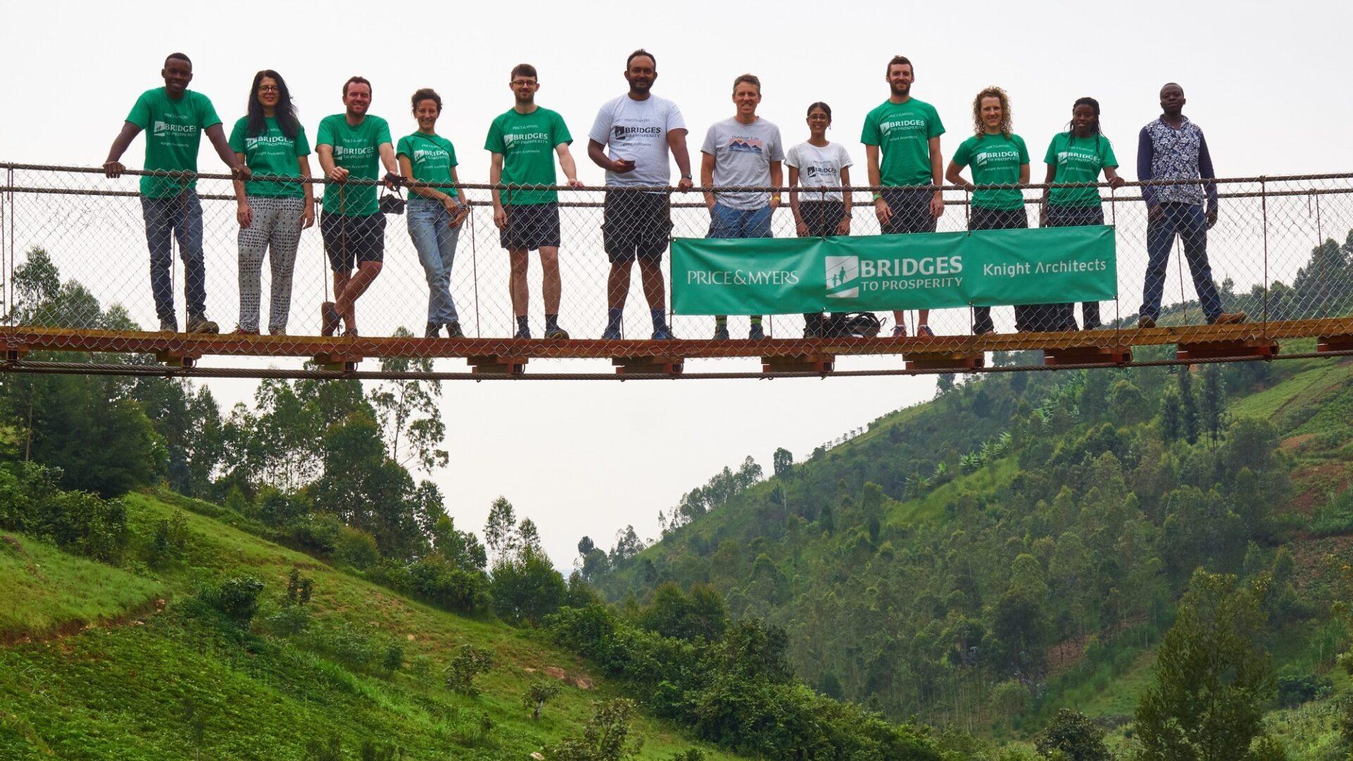 Bridges to Prosperity team posing for photo on bridge
