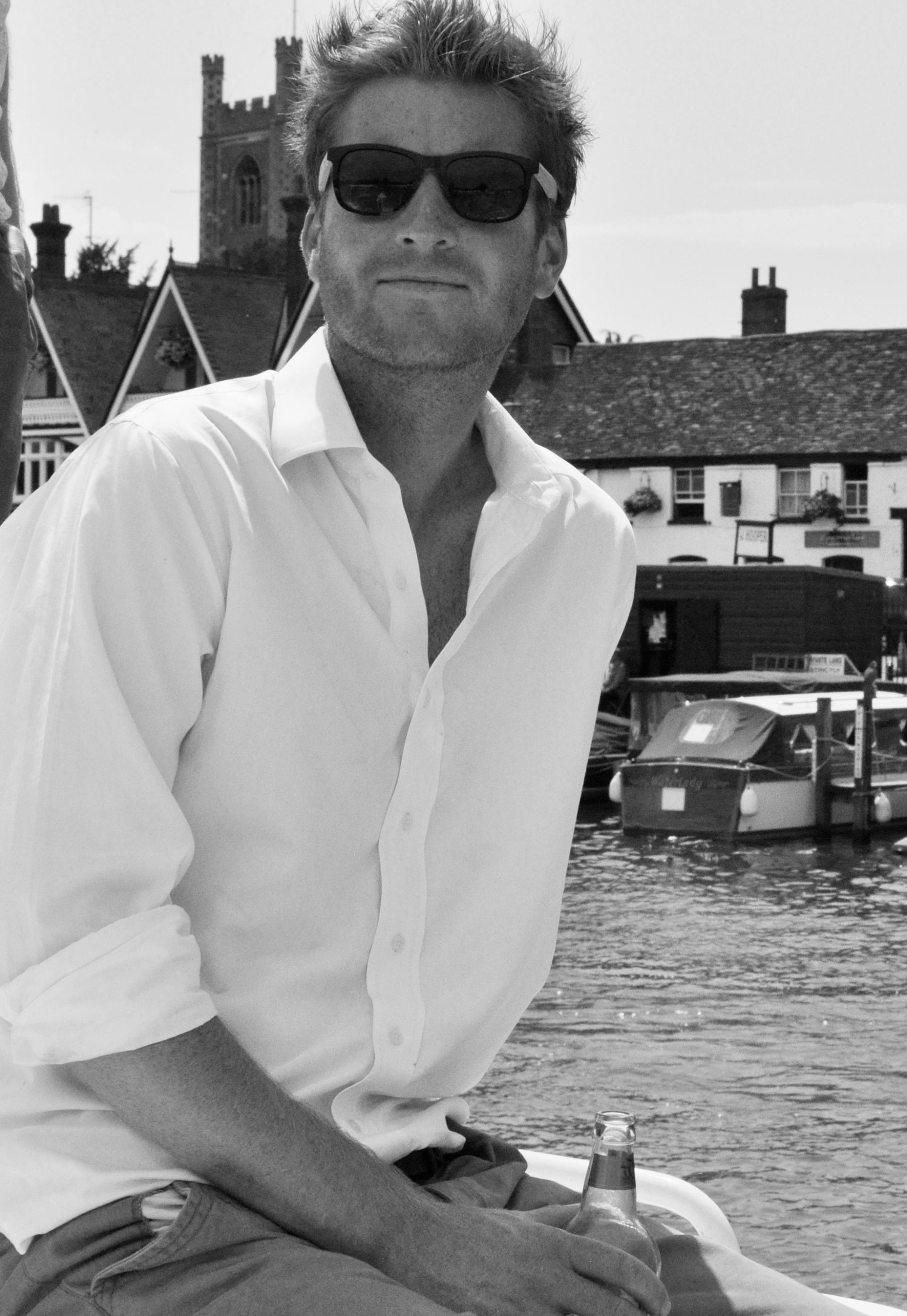 Sam White in sunglasses and shirt