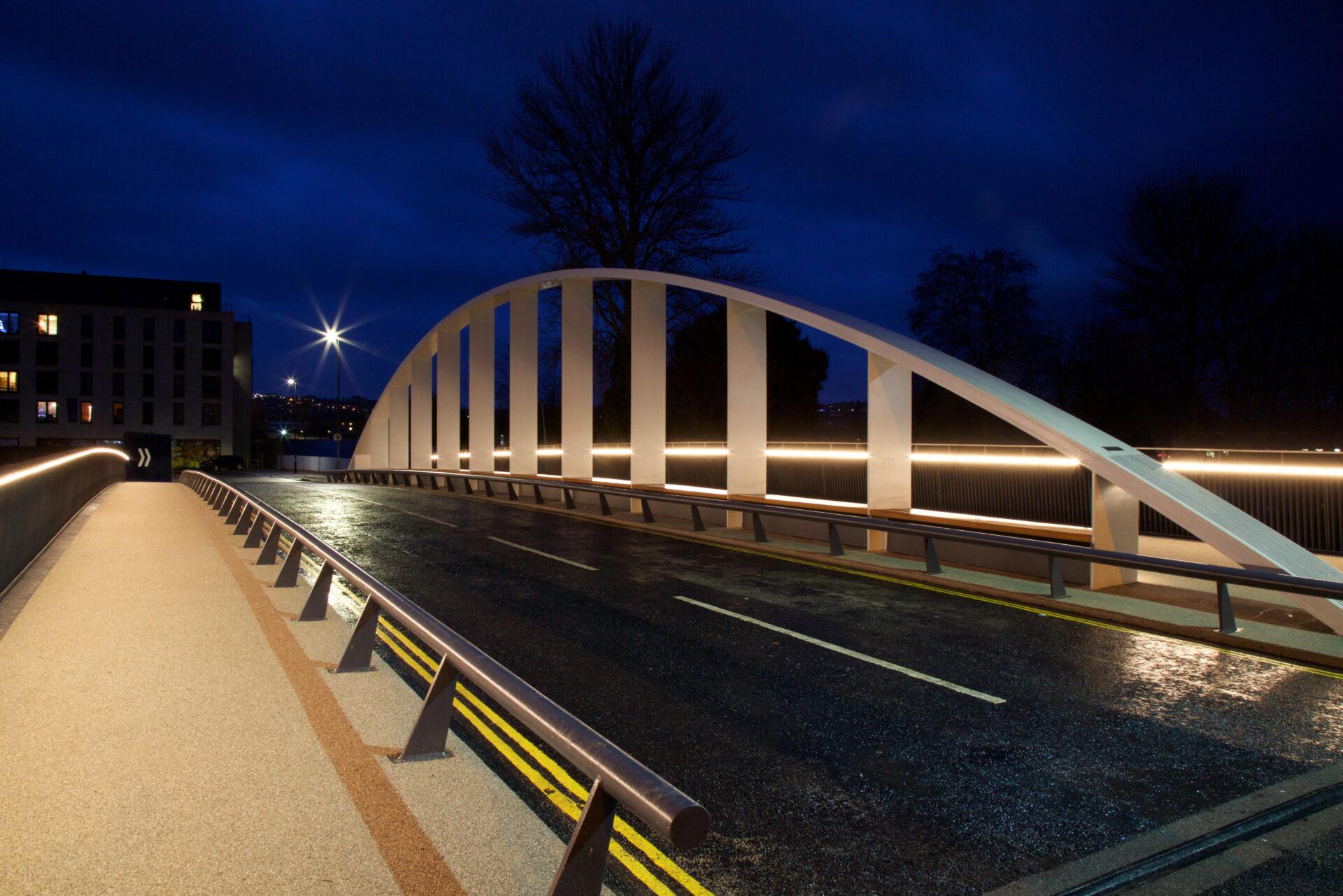 Destructor bridge lit up against a dark night sky