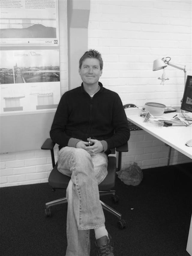 Sam white sitting down in the studio