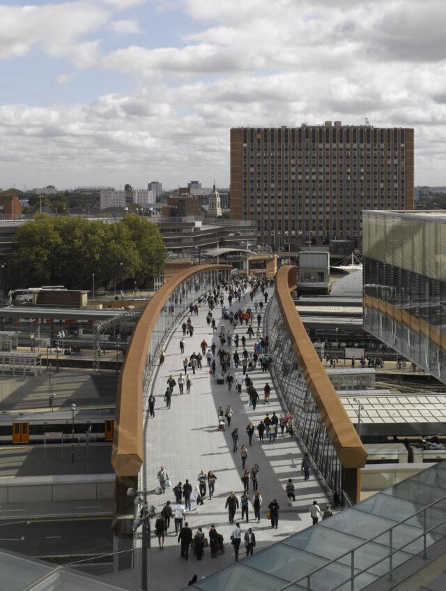 Looking down at pedestrians on Town Centre Link Bridge at Westfield Stratford