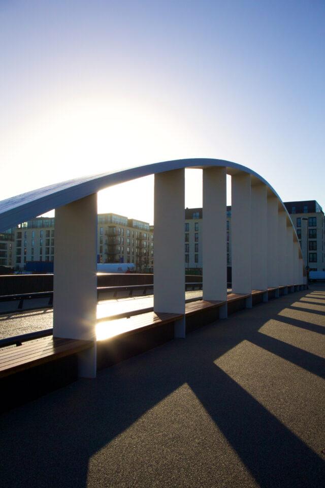 The sun setting behind the Destructor bridge casting shadows on the floor