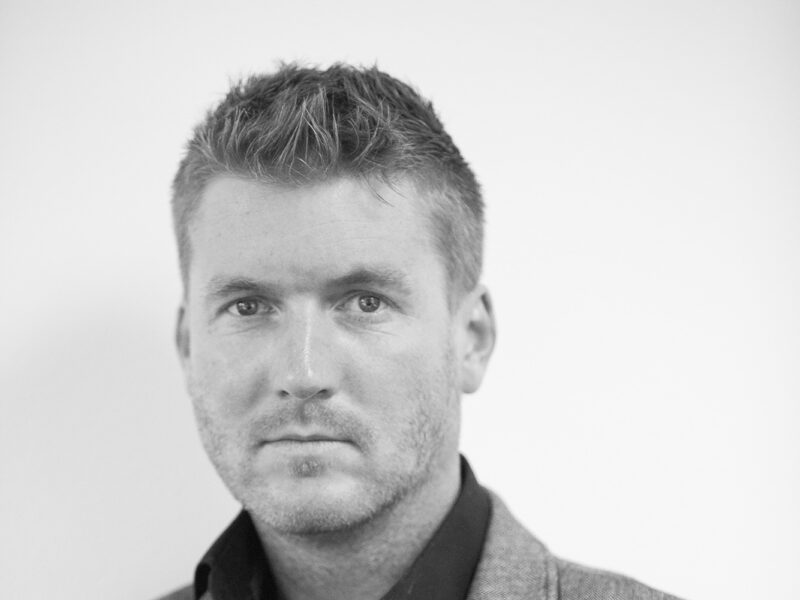 black and white portrait image of Sam White, Director of Knight Architects