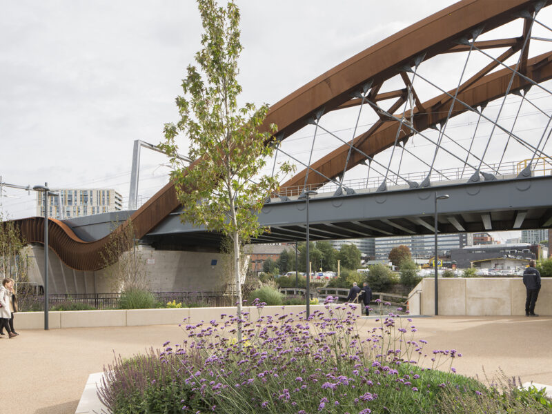 View of rail bridge from pedestrianised area alongside the bridge