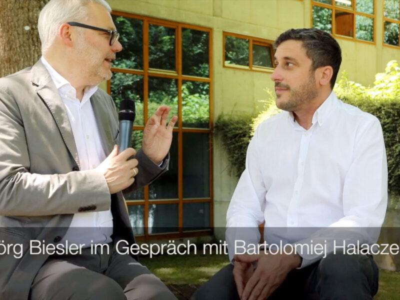 Picture of Jorg Biesler interviewing Bartlomiej Halaczek
