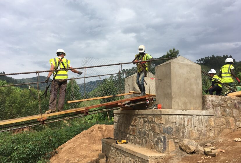 Workers in high visibility vests constructing bridge