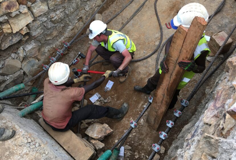 Workers arranging and securing the suspension cables