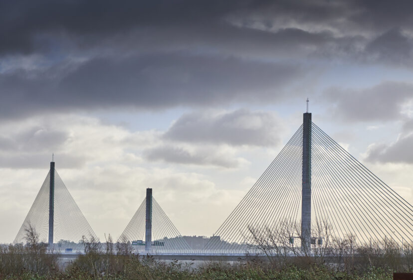 Mersey Gateway three Cable Stayed pylons against a cloudy backdrop.