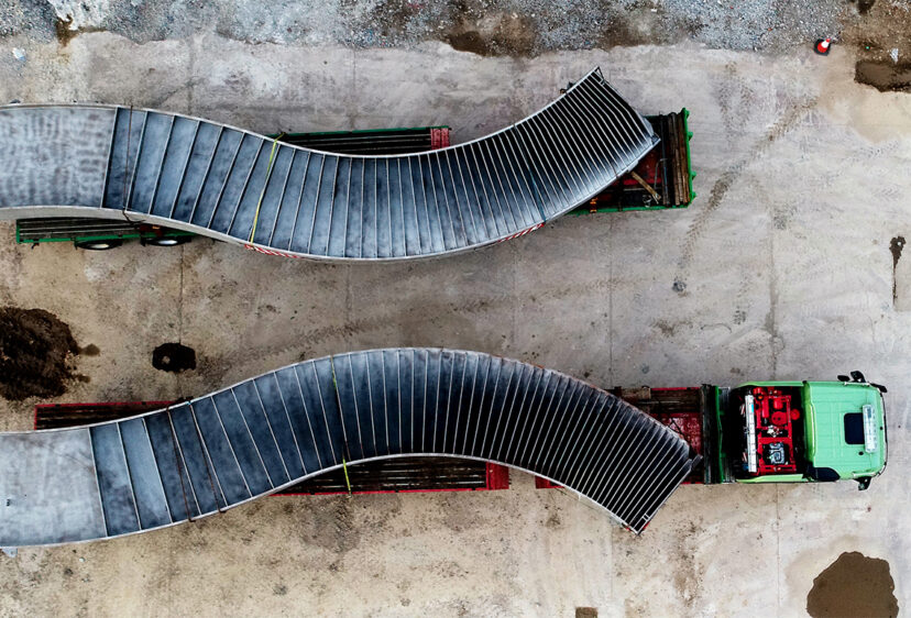 Aerial view looking down at the bridge curves on the back of transporters