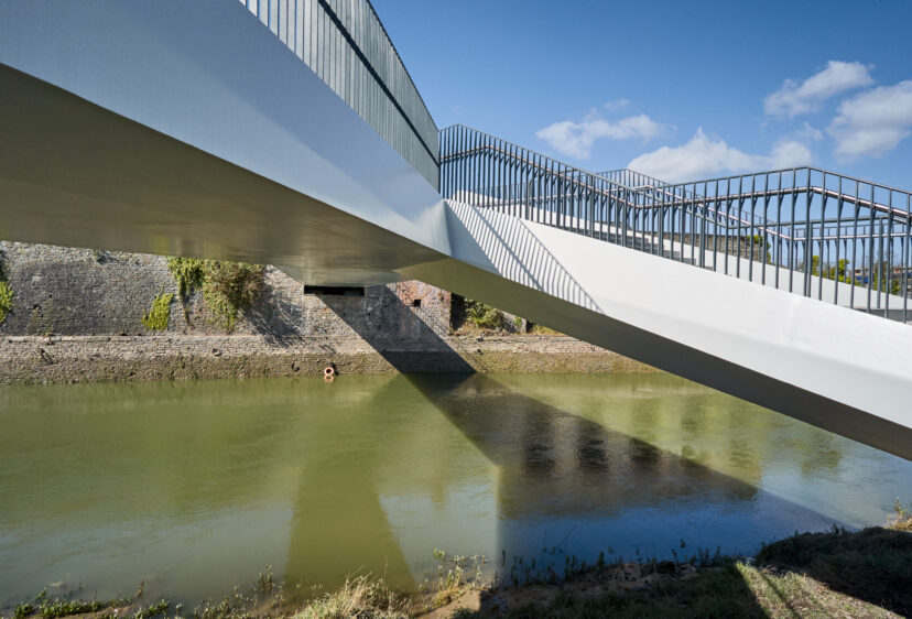 Abutment, edge beam and parapet with river below of footbridge crossing the River Avon