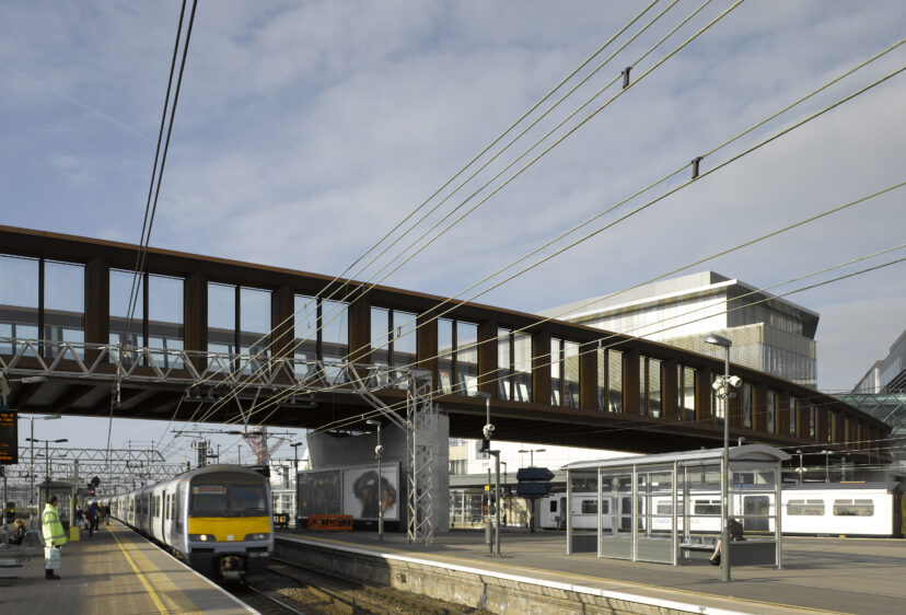 View looking up at Town Centre Link Bridge from station platform below