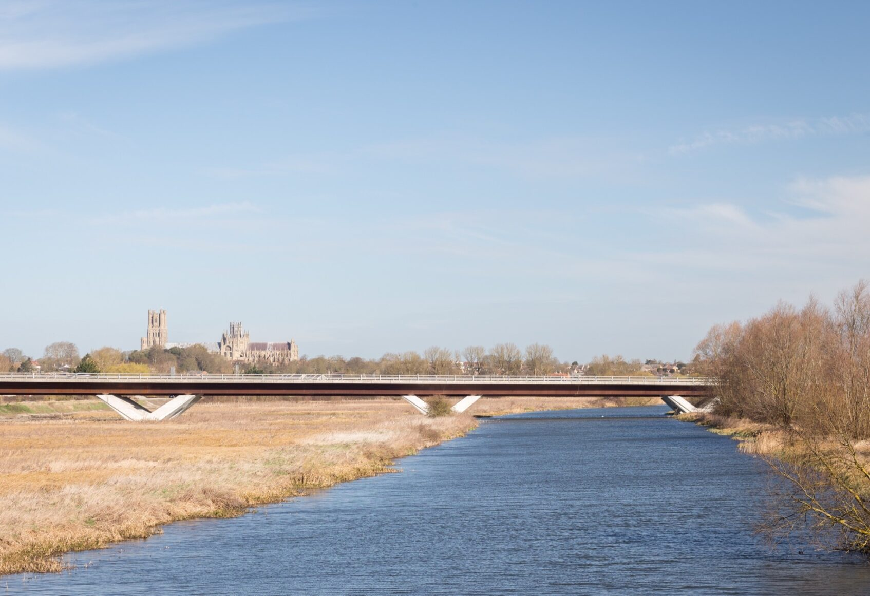 Down river view looking at Ely bypass with Ely Cathedral in the distant behind it