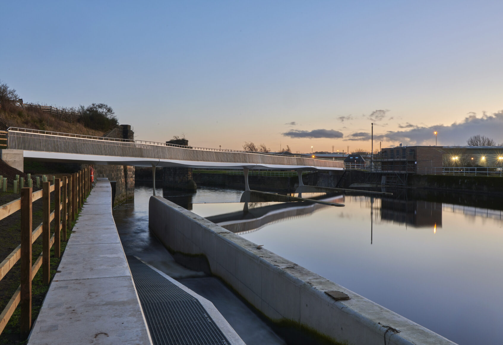 Foot and cycle bridge in Leeds crossing the River Aire, designed by Knight Architects