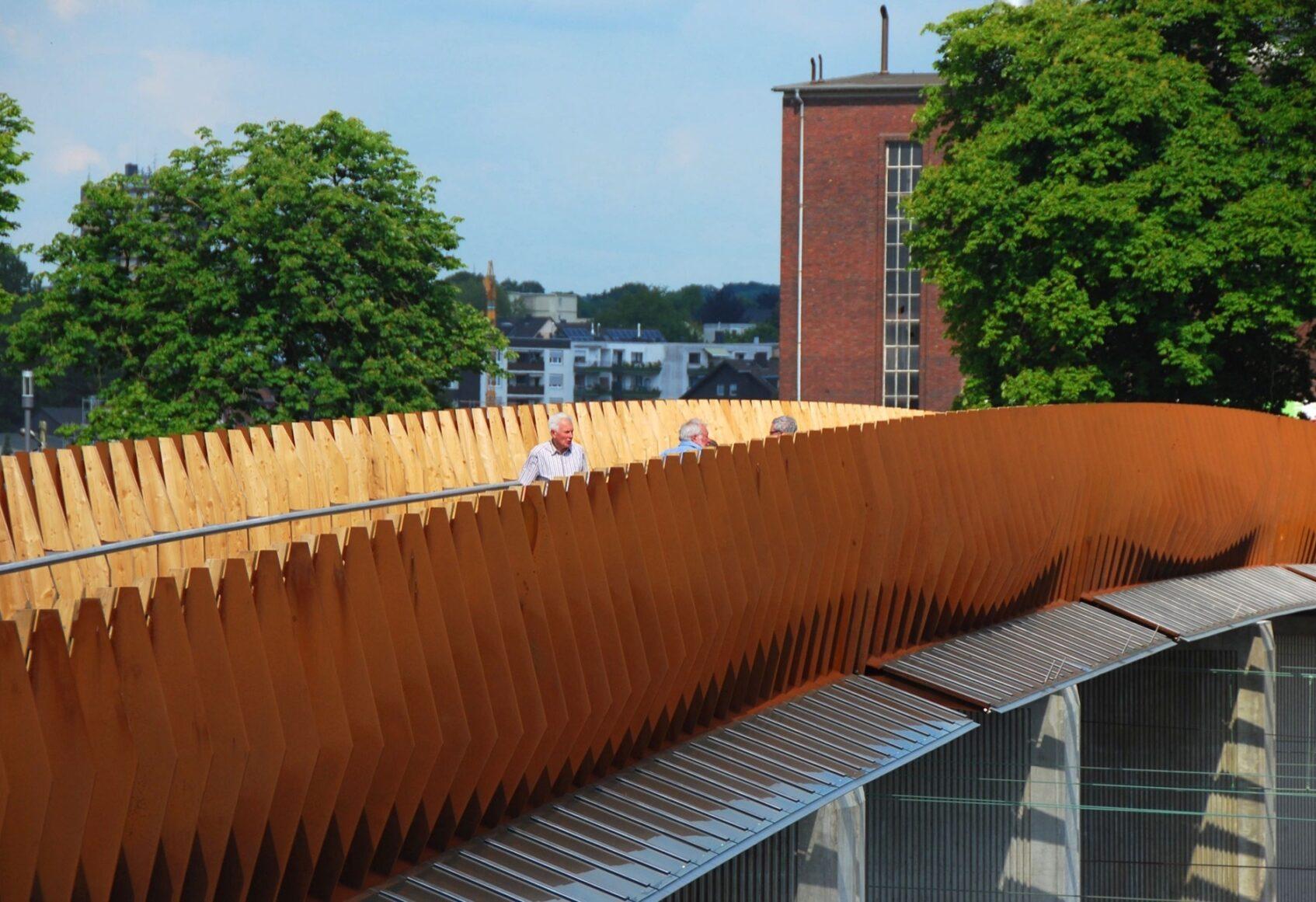 Opladen bridge side view with people walking on the bridge