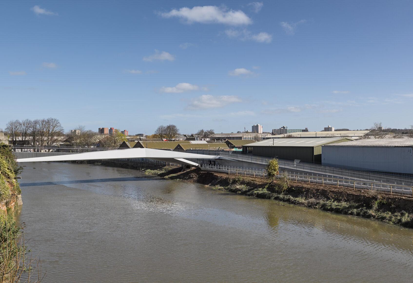 Footbridge in distance crossing River Avon in Bristol